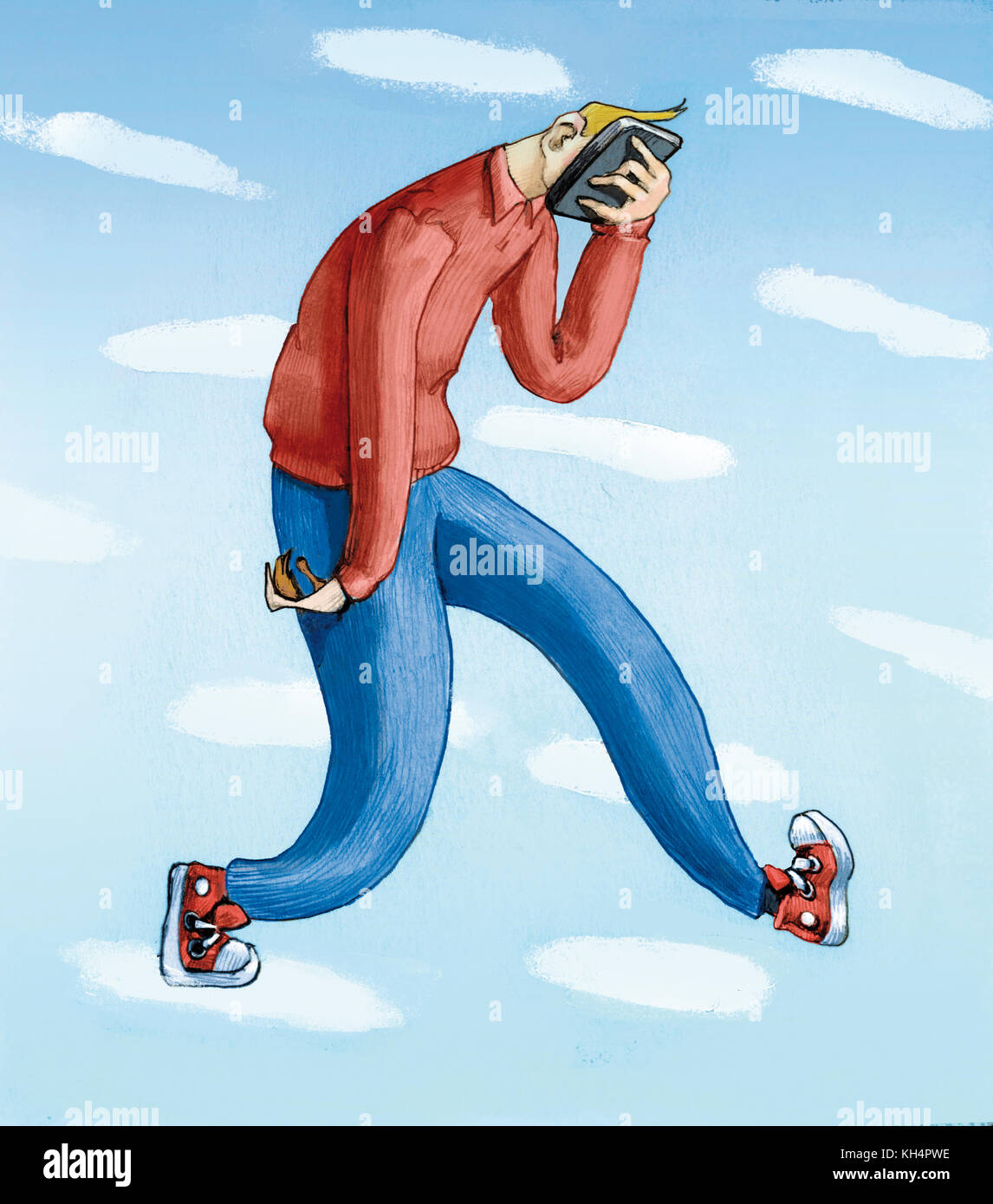 a guy walks with his face completely immersed in a smartphone - Stock Image