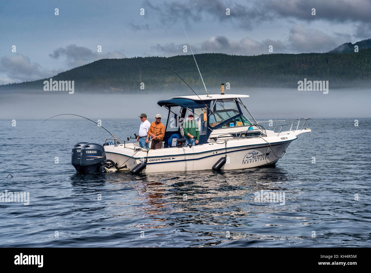 Fishing boat, foggy day in Johnstone Strait off Vancouver Island, British Columbia, Canada - Stock Image