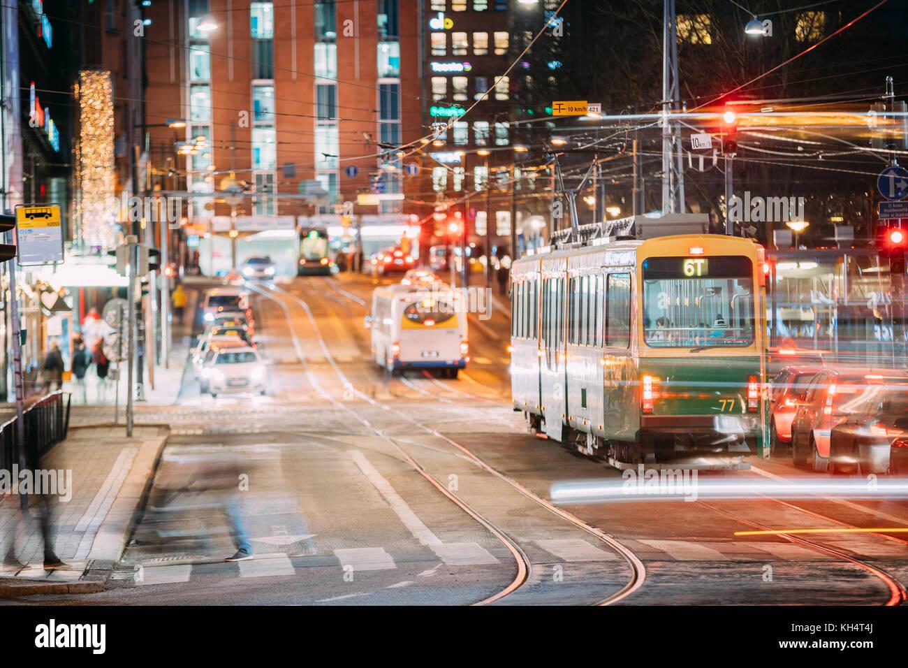 Helsinki, Finland. Tram Departs From A Stop On Kaivokatu Street In Helsinki. Night View Of Kaivokatu Street In Kluuvi - Stock Image