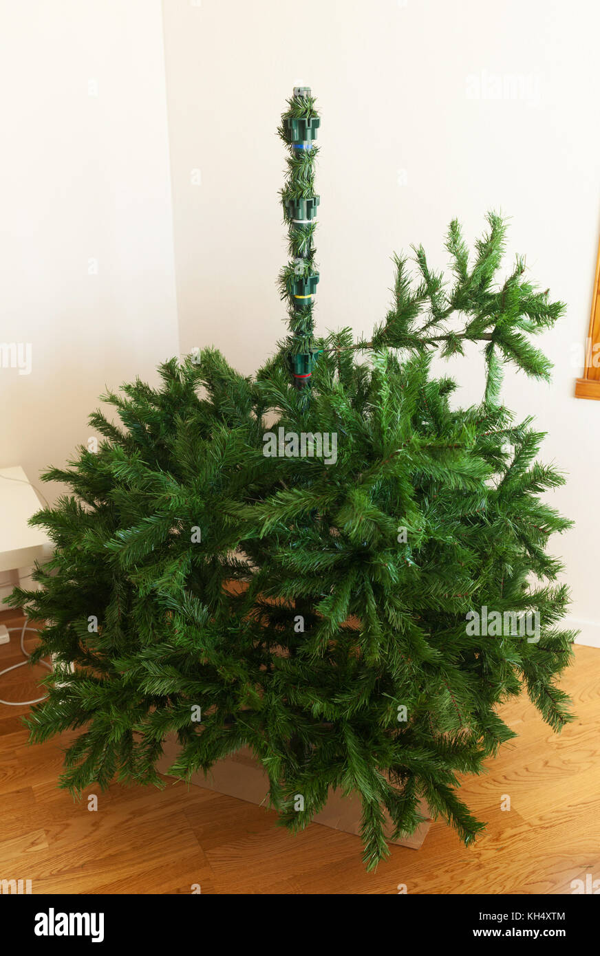 Mounting artificial Christmas tree. Each piece is placed according ...