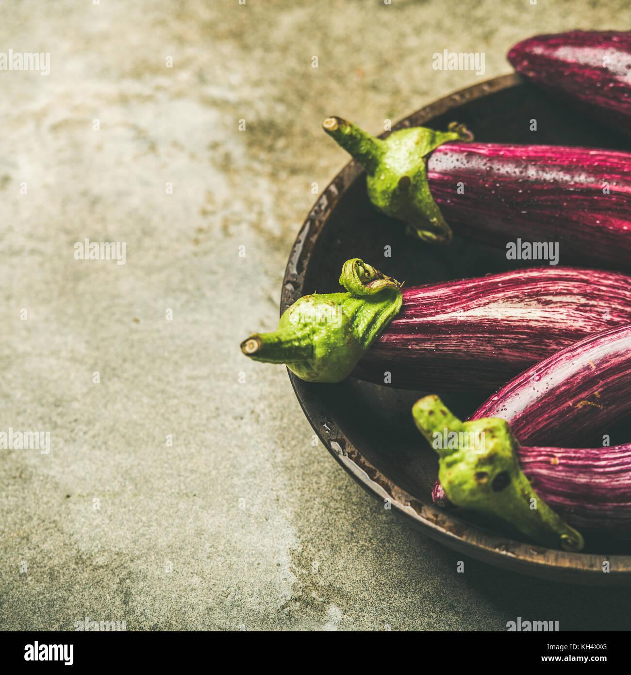 Fresh raw Fall harvest purple eggplants, copy space - Stock Image