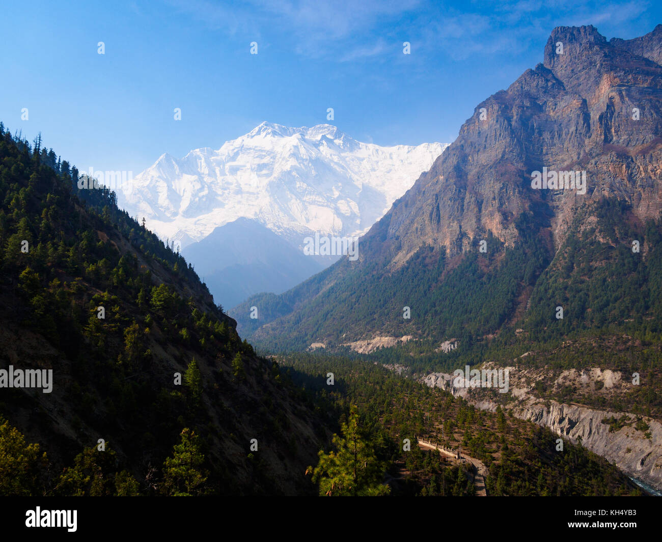 View down over the Marsyangdi River valley and across to Annapurna II from the path to Ghyaru, Annapurna Circuit - Stock Image