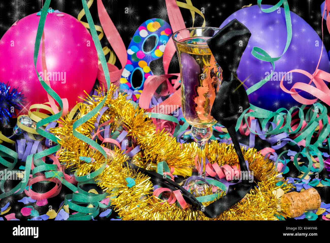 New Year party with champagne glass and bowtie and star rain on black background - Stock Image