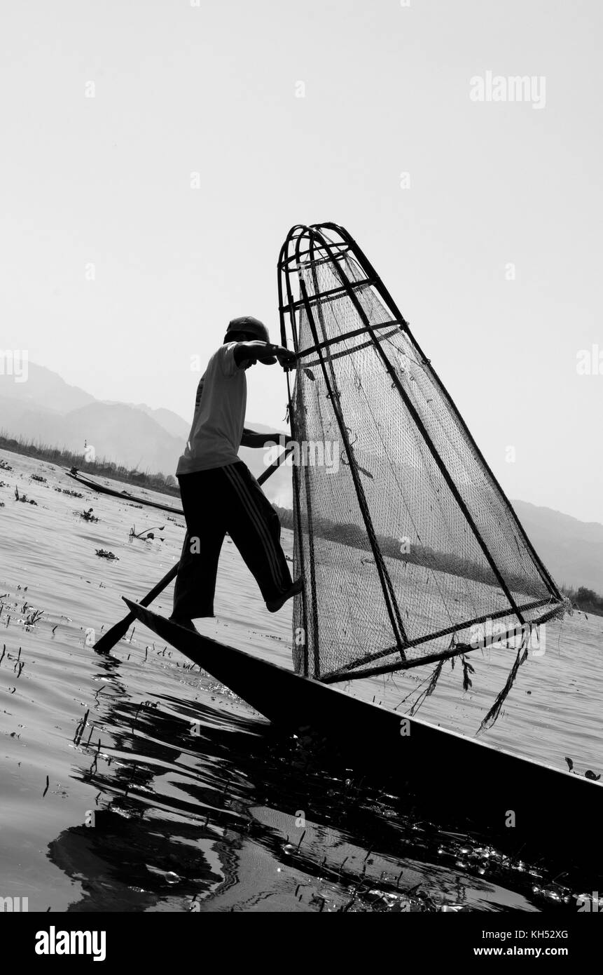 Fisherman rowing with one leg in Inle Lake Myanmar, Burma - Stock Image
