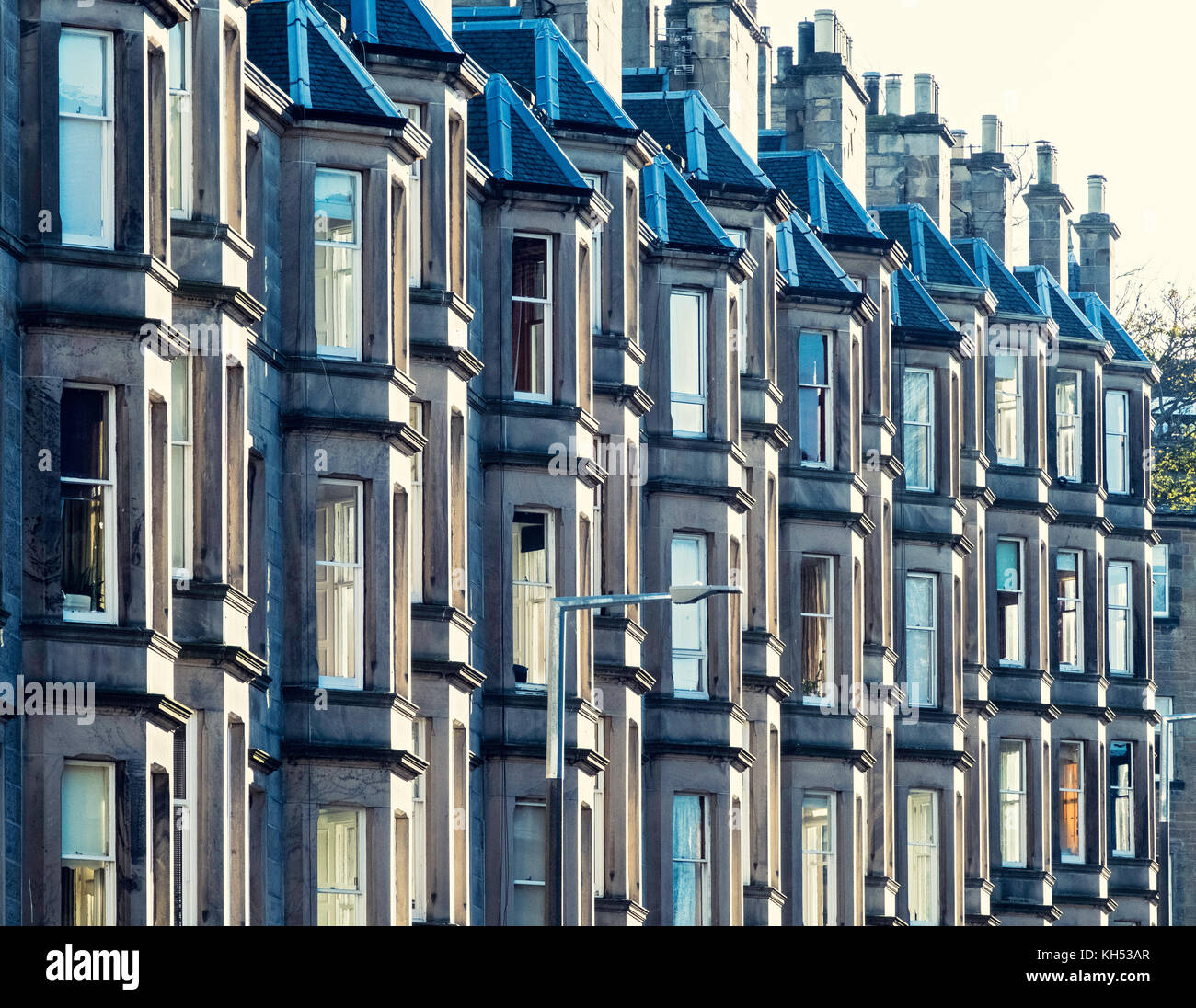 Detail of row of sandstone terraced apartments (tenements) on Comely Bank Avenue in Edinburgh, Scotland, United - Stock Image