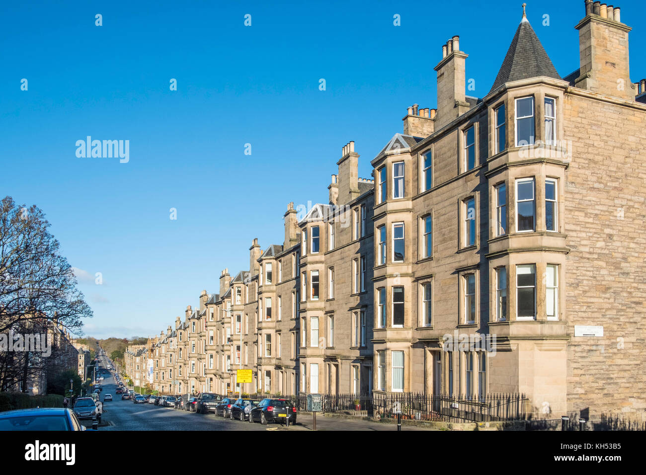 View of row of sandstone terraced apartments (tenements) on Comely Bank Avenue in Edinburgh, Scotland, United Kingdom - Stock Image