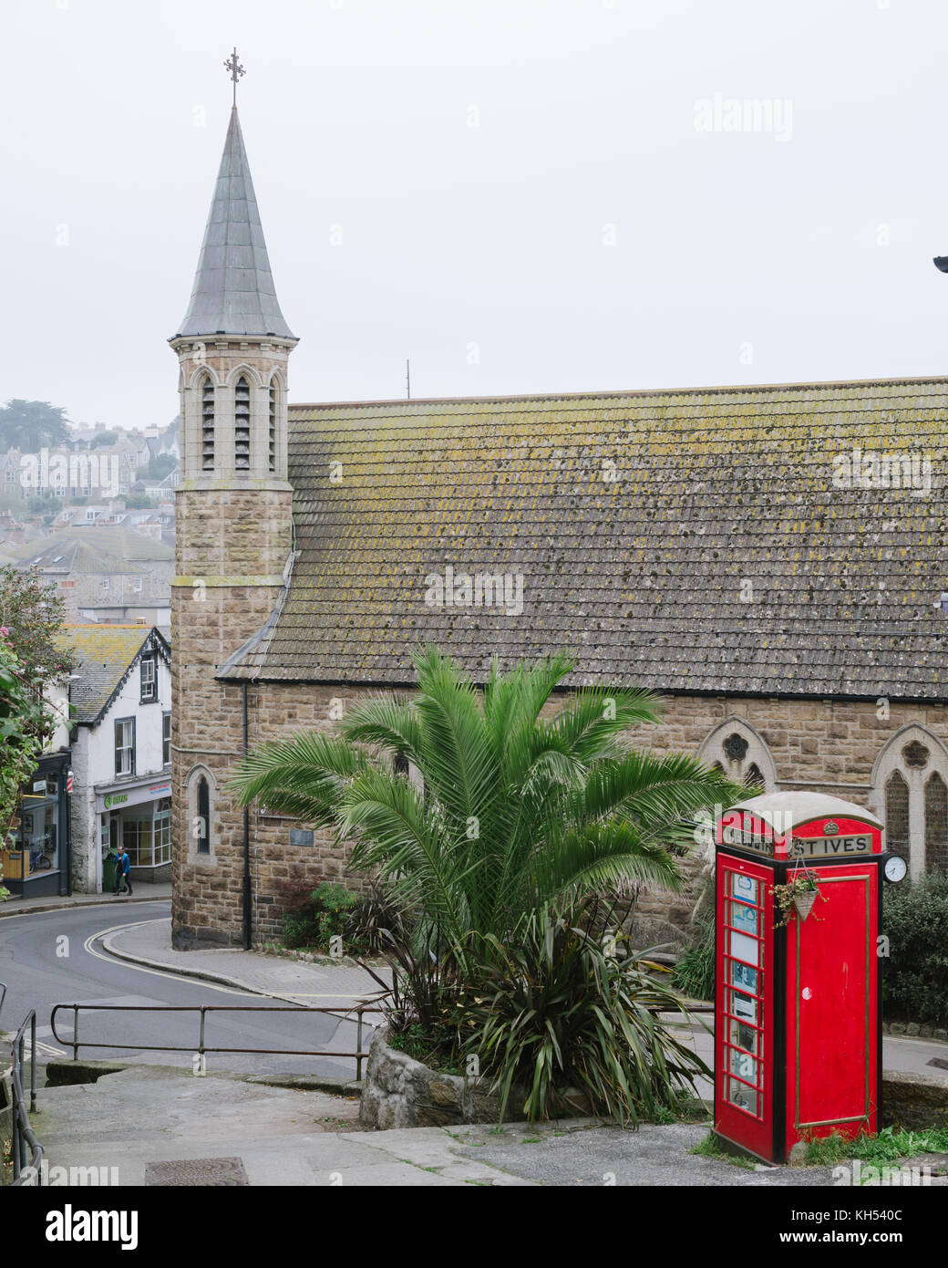 Phone box in St Ives with church in the background - Stock Image