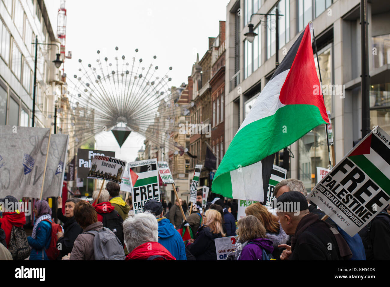 Protestors for Palestinian rights march past the Oxford Street Christmas lights on the centenary of the Balfour - Stock Image