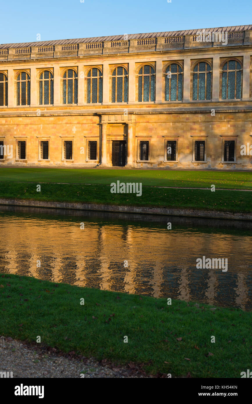 Scenic view of the Wren Library at sunset, Trinity College, Cambridge University; with punting in front on the river Cam, UK. Stock Photo