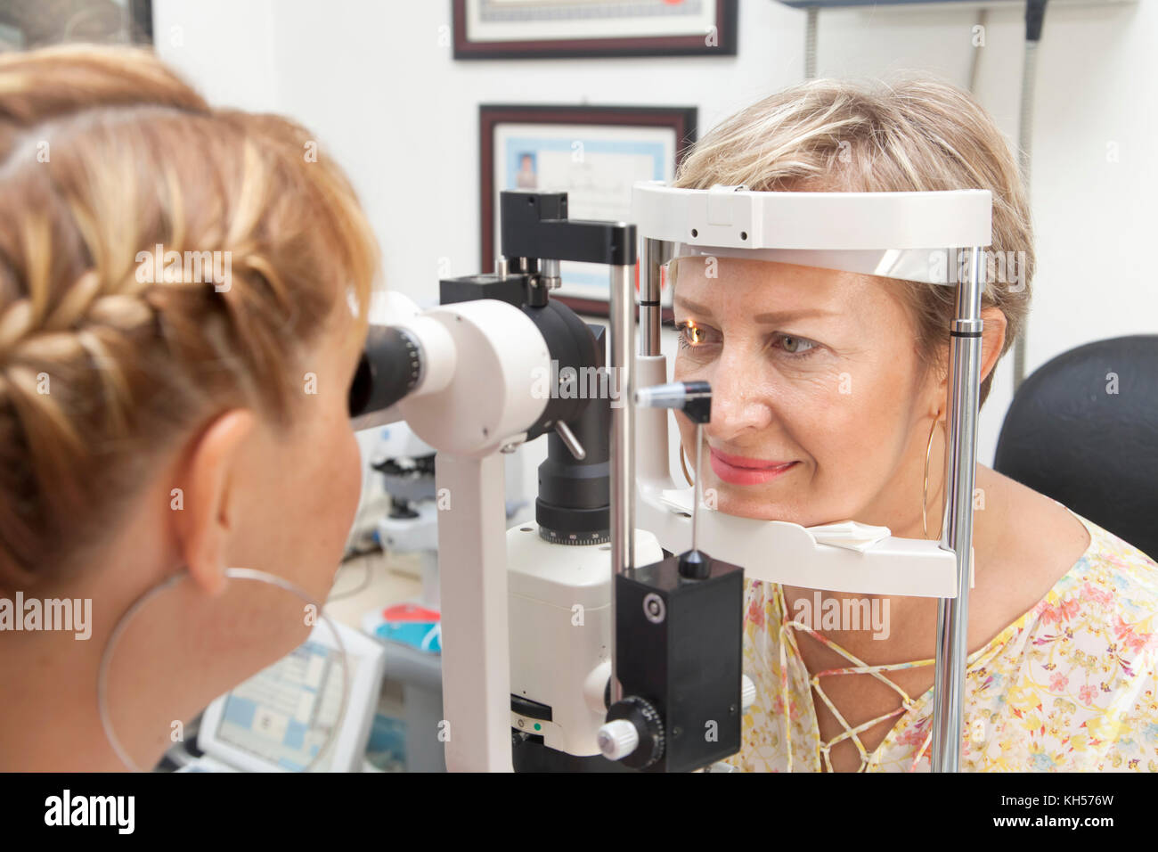 Young woman is being examined of her eyesight by optometrist - Stock Image