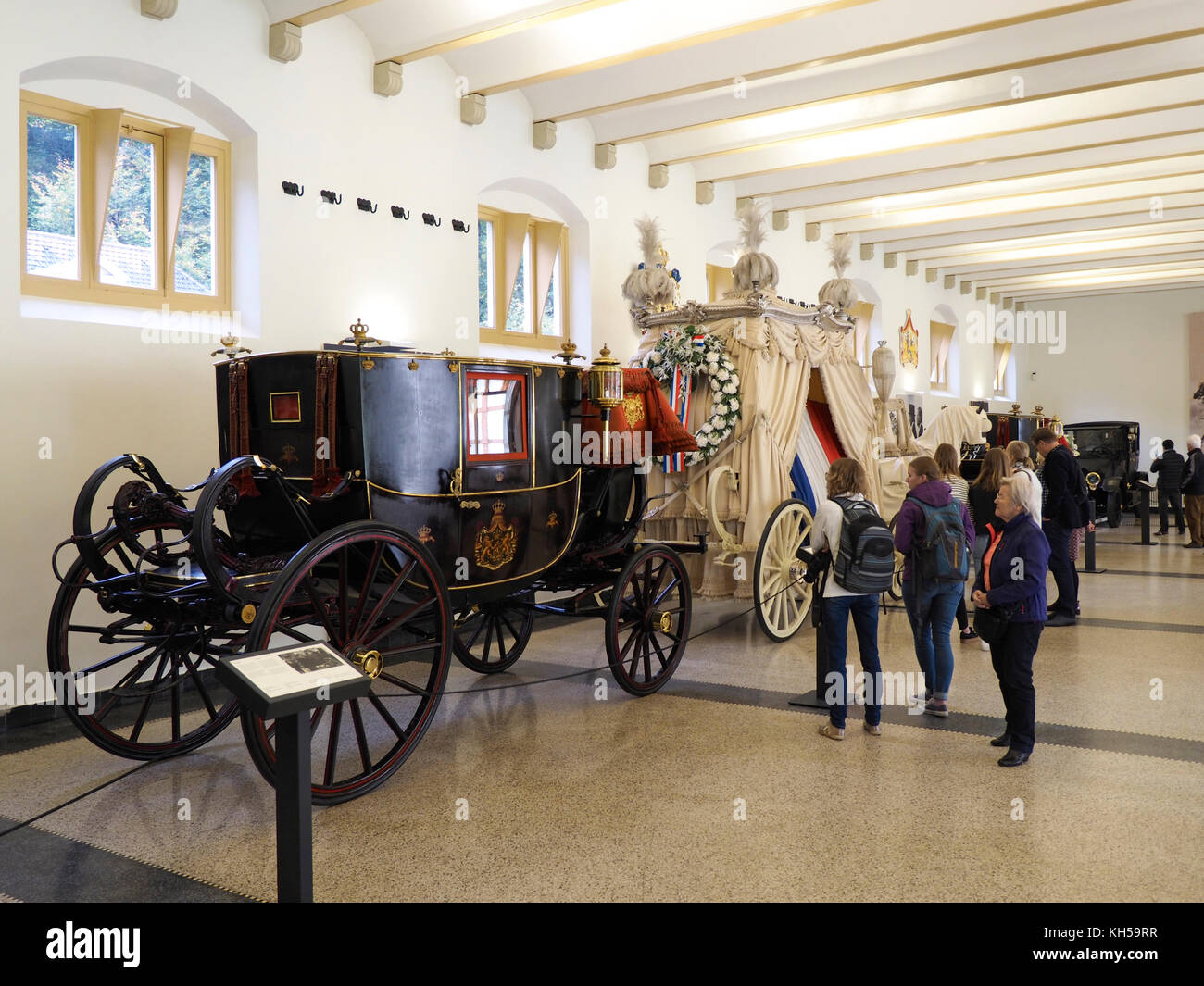 Carriages of the Dutch Royal Family on display in the stables of the het Loo Palace in Apeldoorn, Gelderland, the - Stock Image