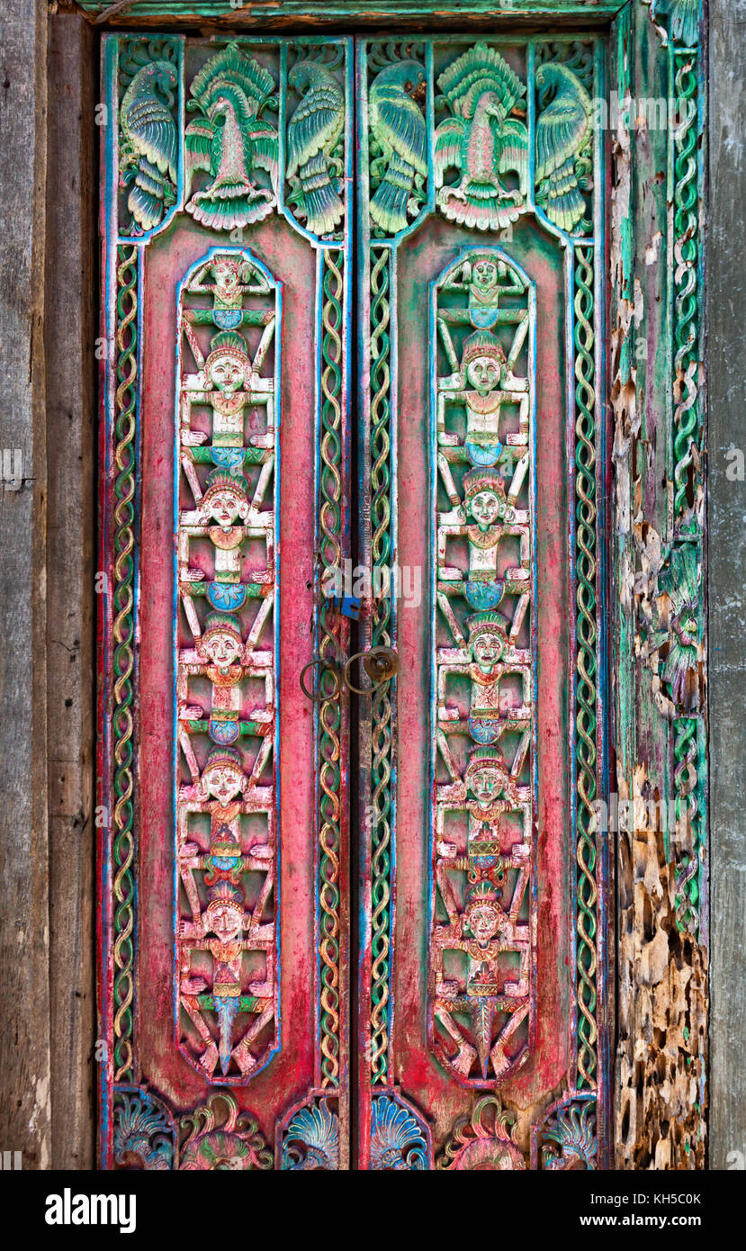 Old teak wood door with traditional carving in a Balinese temple decorated ornament people figures & Traditional Balinese Door Stock Photos u0026 Traditional Balinese Door ...