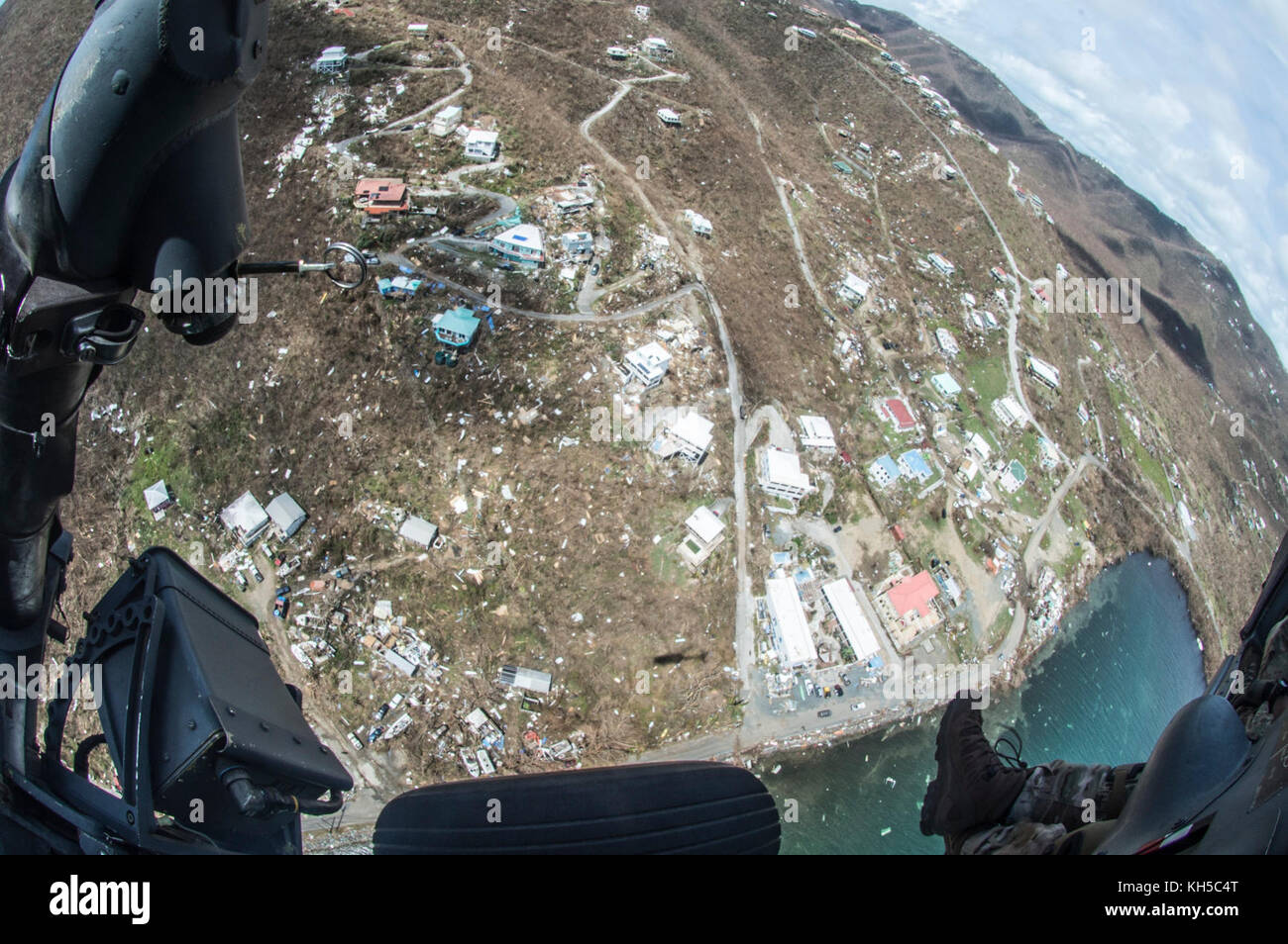 Aircrew survey the destruction from the helicopter over the U.S. Virgin Islands.  Airmen from the New York Air National Stock Photo