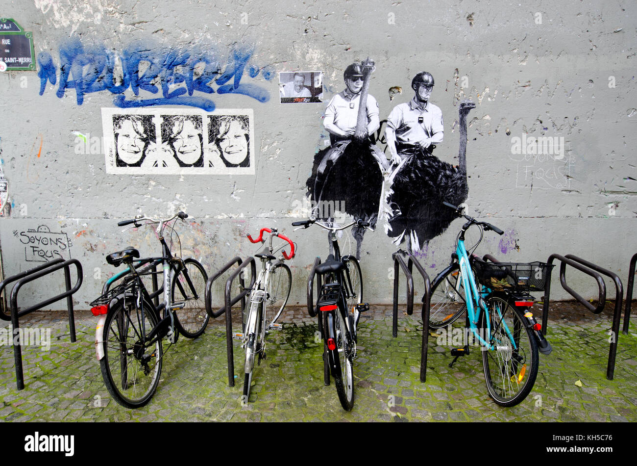 Graffiti Bicycle Bicycles Stock Photos Police Roadbike Toronto Greey Blue Mounted On Ostriches Rack Rue Du