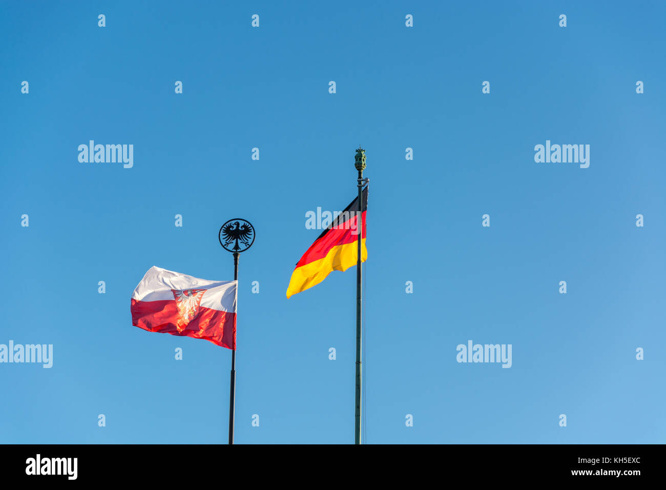 German and Frankfurt flag above the Festhalle at the exhibition center in Frankfurt with blue sky Stock Photo