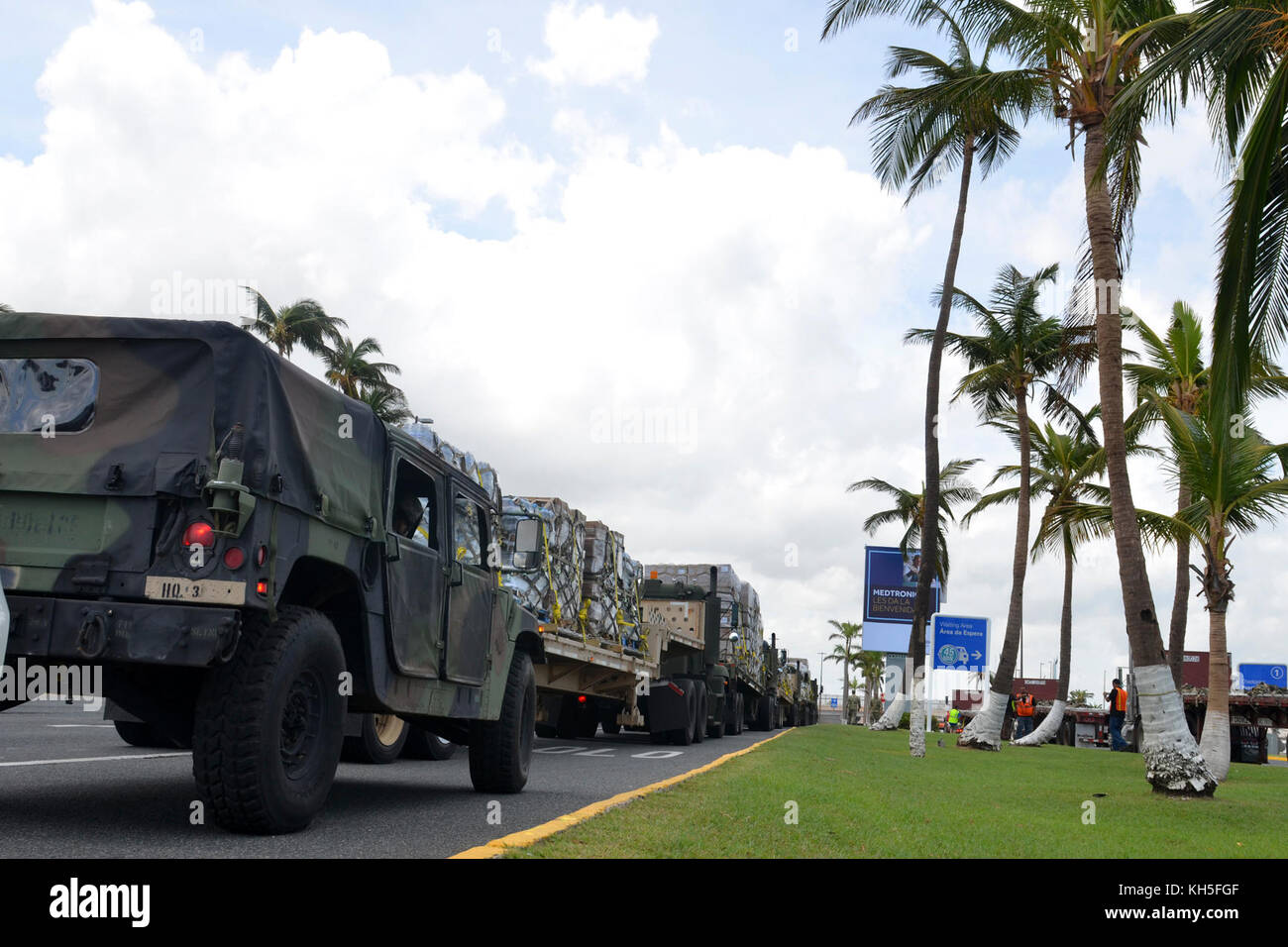 A U.S. Army Reserve distribution convoy from the 1st Mission Support Command stage with food and water outside the - Stock Image