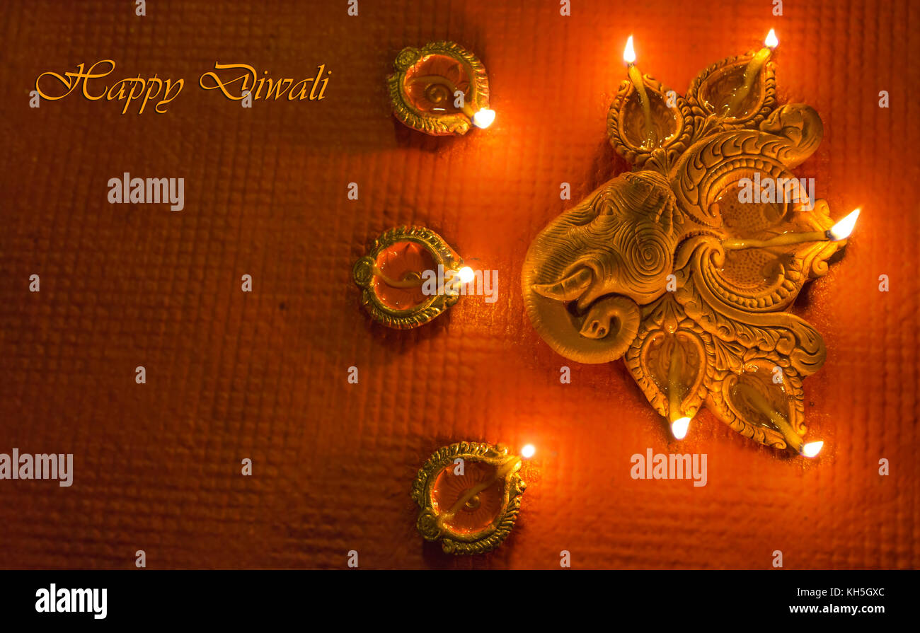 Diwali colorful decorative clay diya lamps for background greetings content - Stock Image