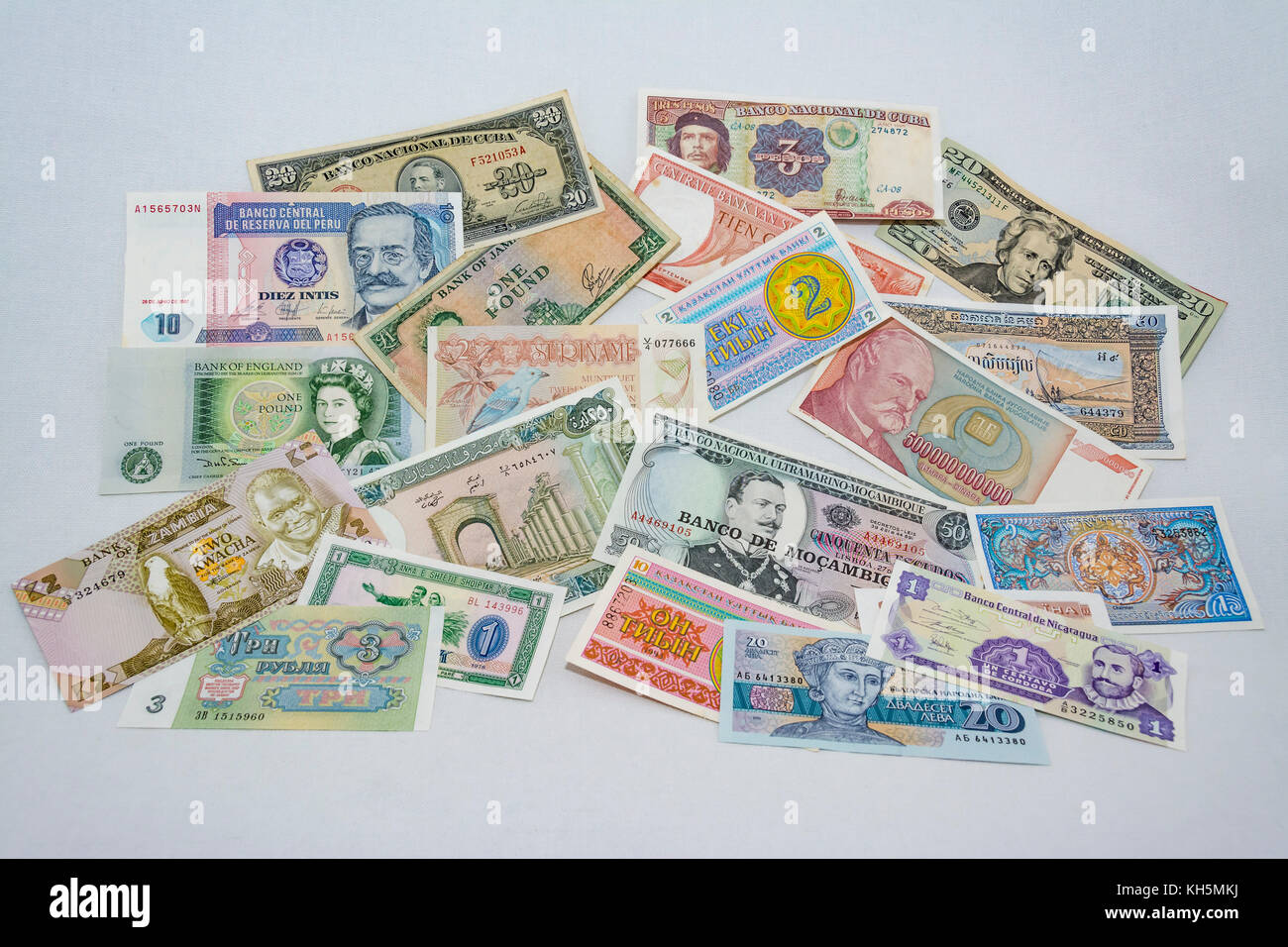 Collage of various old and new international currency banknotes - Stock Image