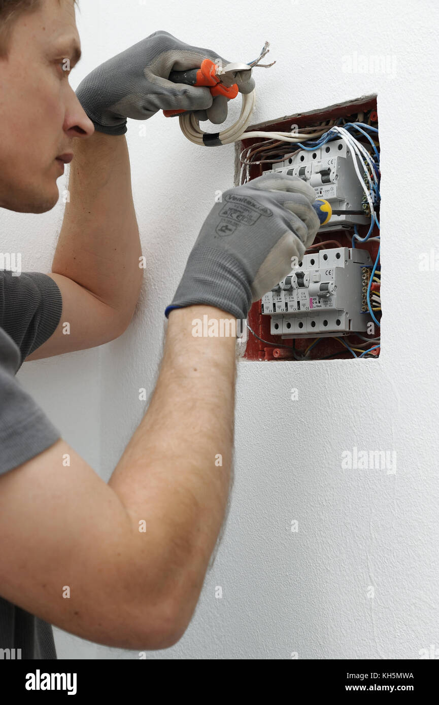 Electric Fuse Box Stock Photos Images Alamy Car Broken Into Open The Electrician Is Setting Circuit Breakers In Image