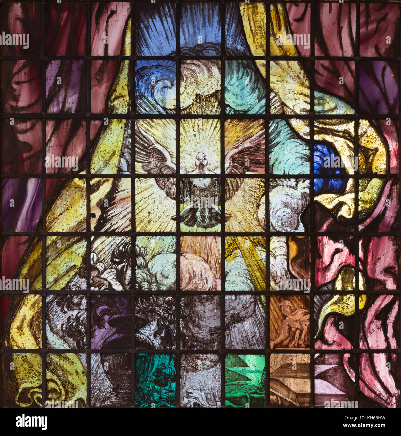 LONDON, GREAT BRITAIN - SEPTEMBER 16, 2017: The dove ast the symbolo of holy spirti on the modern stained glas in Stock Photo