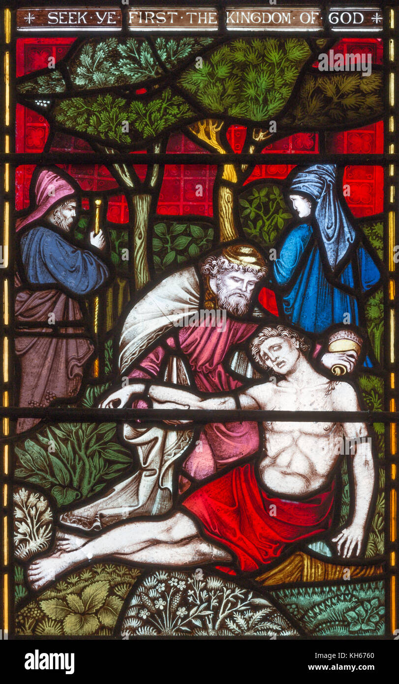 LONDON, GREAT BRITAIN - SEPTEMBER 19, 2017: The Parable of the Good Samaritan  on the stained glass in St Mary Abbot's - Stock Image