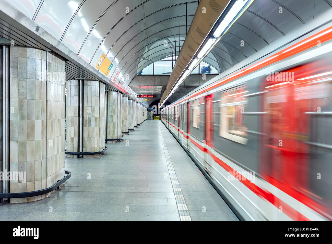 Train leaves empty platform at one of the metro stations in Prague. - Stock Image