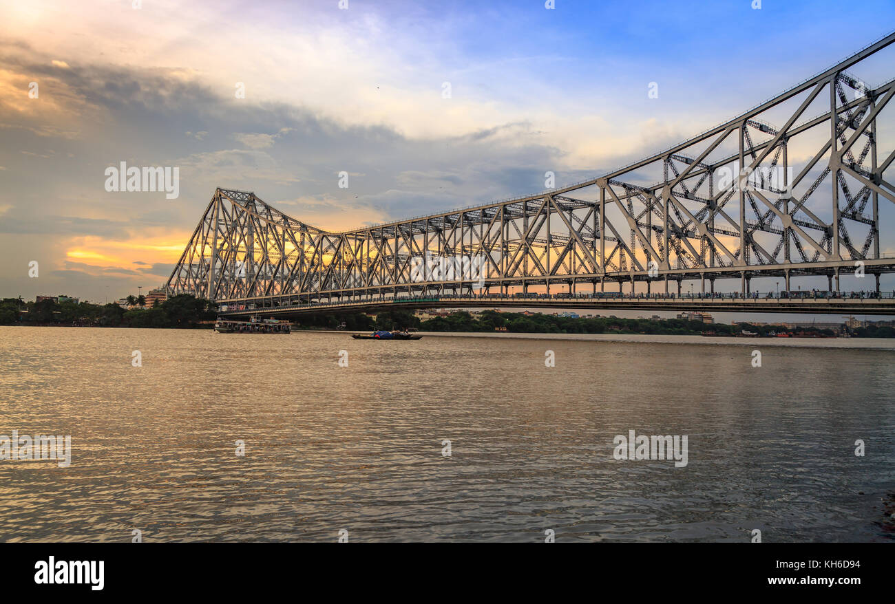Howrah bridge Kolkata - The historic cantilever bridge on river Hooghly with moody sunset sky - Stock Image