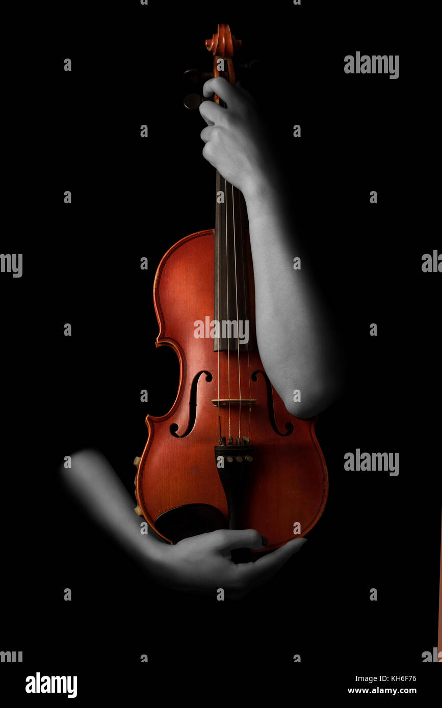 Violin music instrument violinist. Classical player hands. Details of violin playing isolated on black - Stock Image
