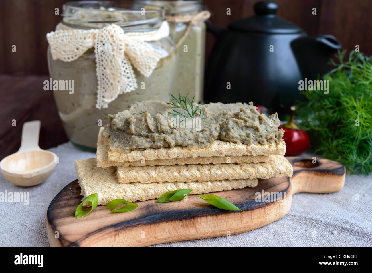 Gentle paste, paste from the eggplant. Dietary dish. Put on a crisp low-calorie diet fitness bread. Vegan cuisine. - Stock Image