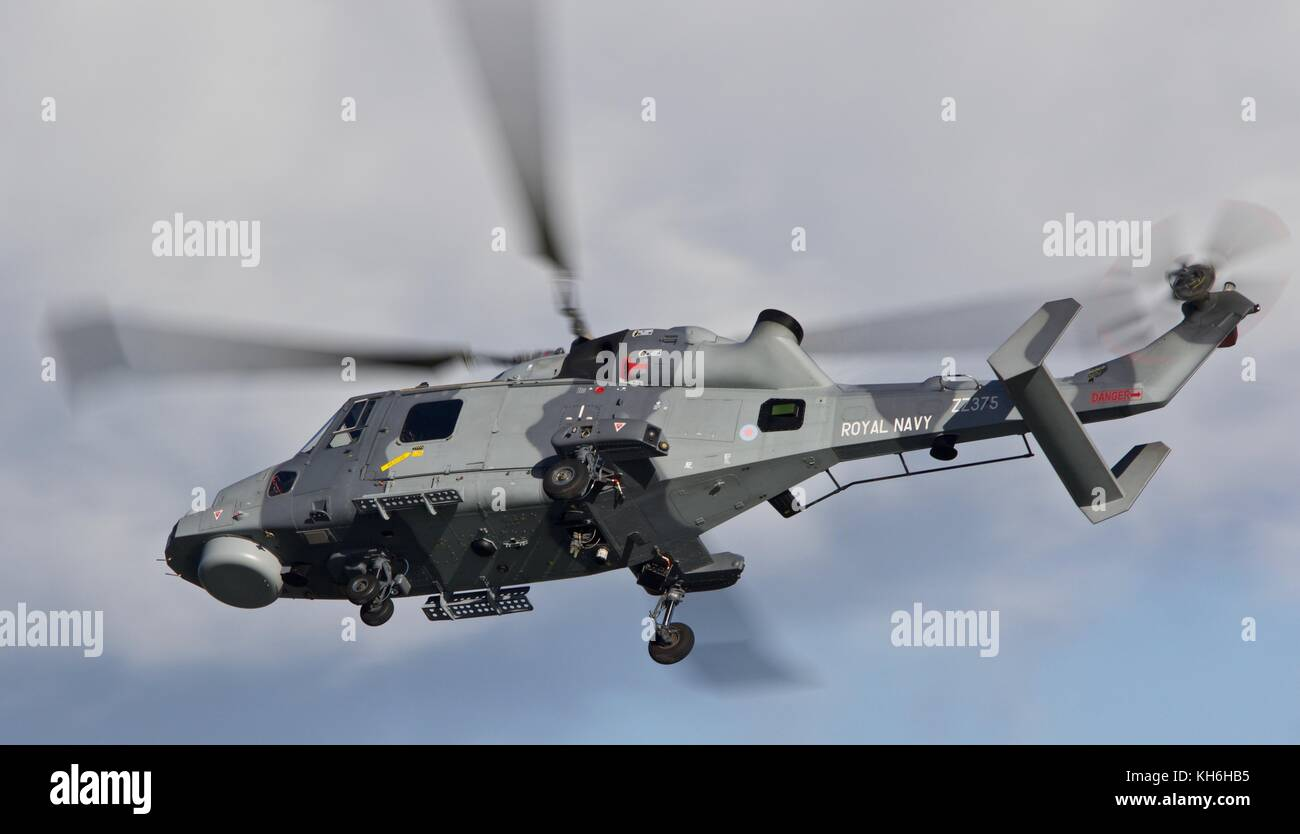 Royal Navy Wildcat  AgustaWestland AW159 is a Search and Rescue and Anti Surface Warfare helicopter. Flying over - Stock Image