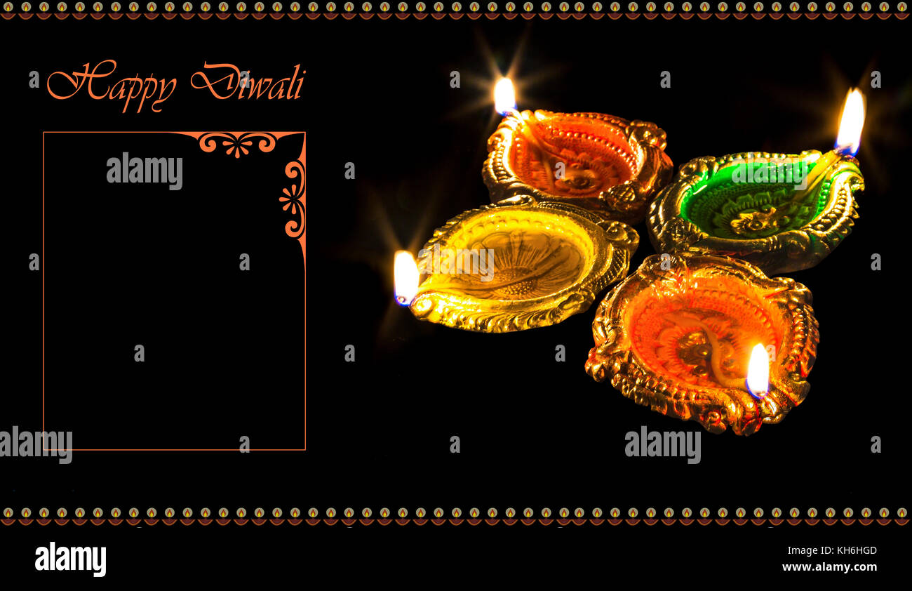 Diwali greetings stock photos diwali greetings stock images alamy diwali colorful burning clay diya lamps isolated in dark background with space for greetings content m4hsunfo