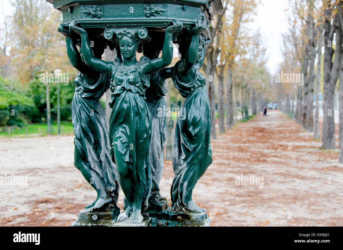 Paris, France. Wallace Fountain on the Avenue des Champs-Élysées - designed by Charles-Auguste Lebourg, - Stock Image