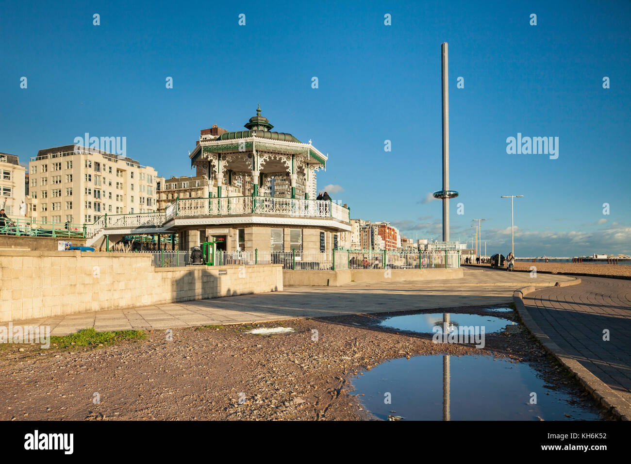 Autumn afternoon on Brighton seafront, East Sussex, England. The Bandstand and i360 tower in the distance. - Stock Image