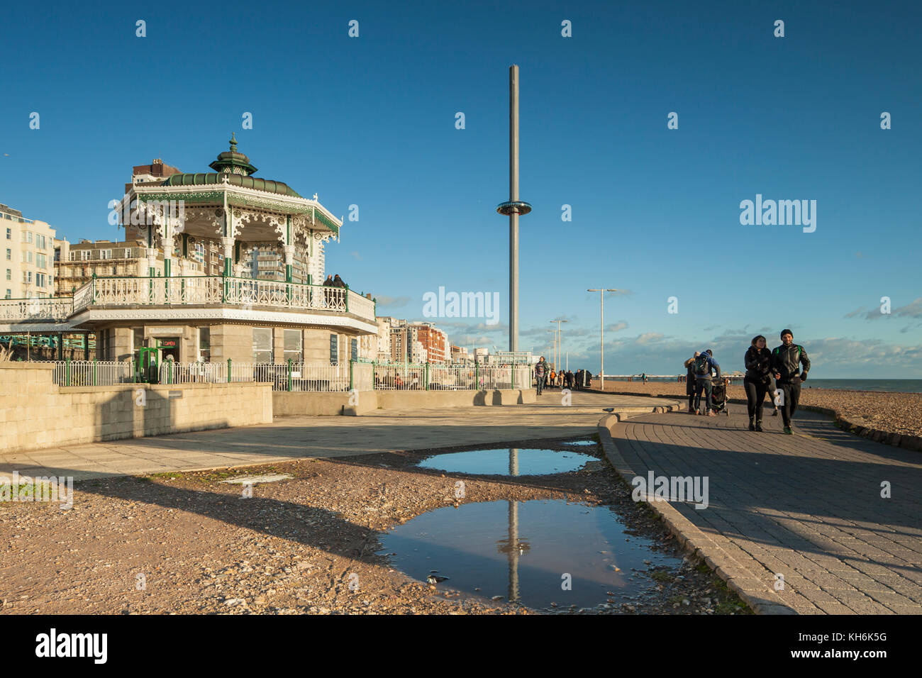Autumn afternoon on Brighton seafront, England. The Bandstand and i360 tower in the distance. - Stock Image