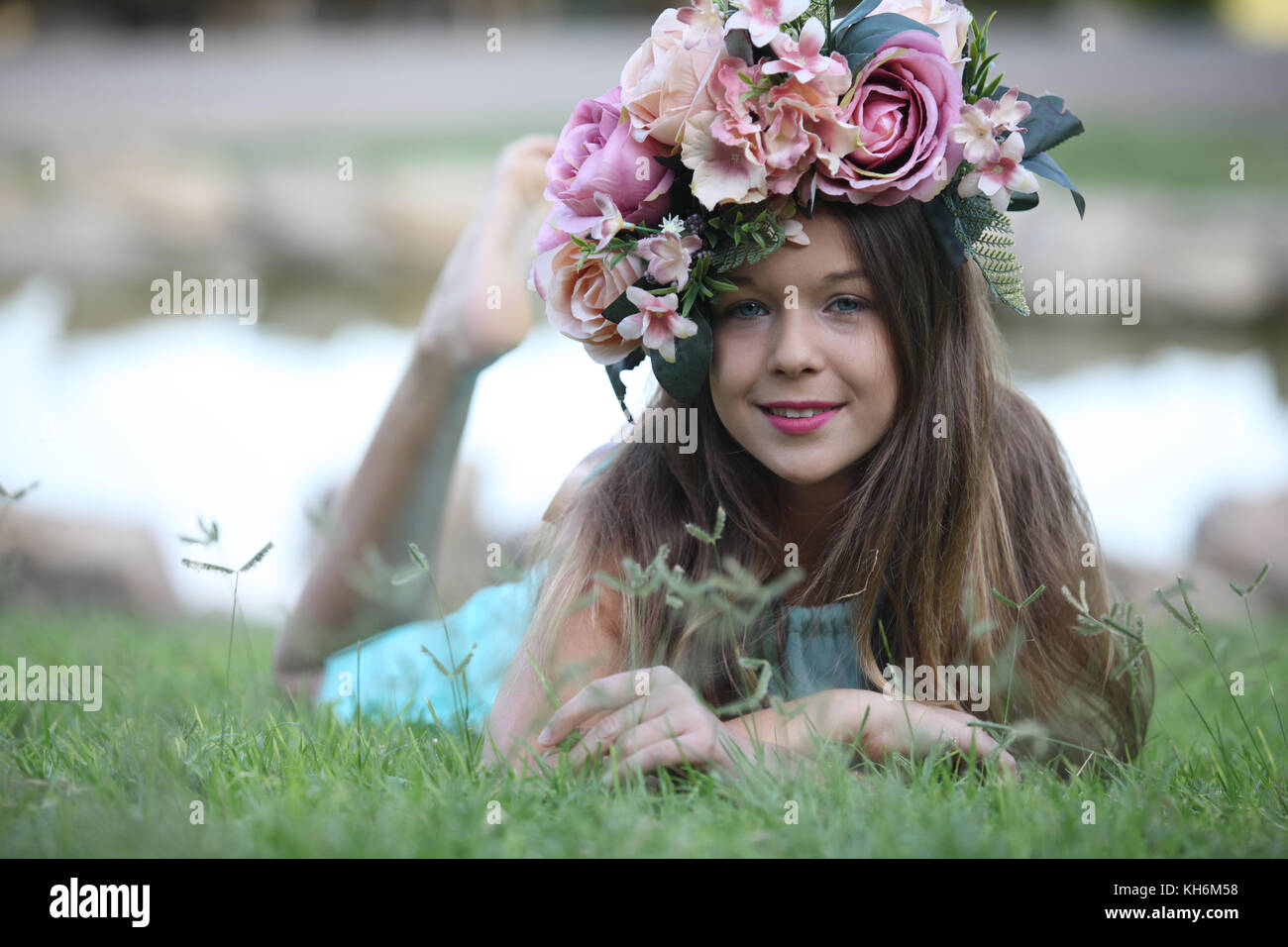 a beautiful 12 year old girl dressed up in a light blue dress, wearing a flower crown. Bat Mitzvah portfolio - Stock Image
