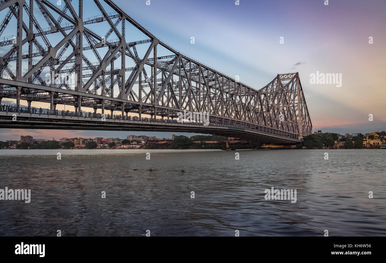Howrah bridge Kolkata - The historic cantilever bridge on river Hooghly with moody sunrise sky - Stock Image