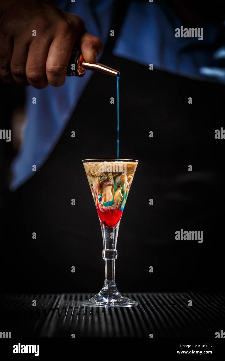 The Bartender makes Alien brain hemorrhage cocktail - Stock Image