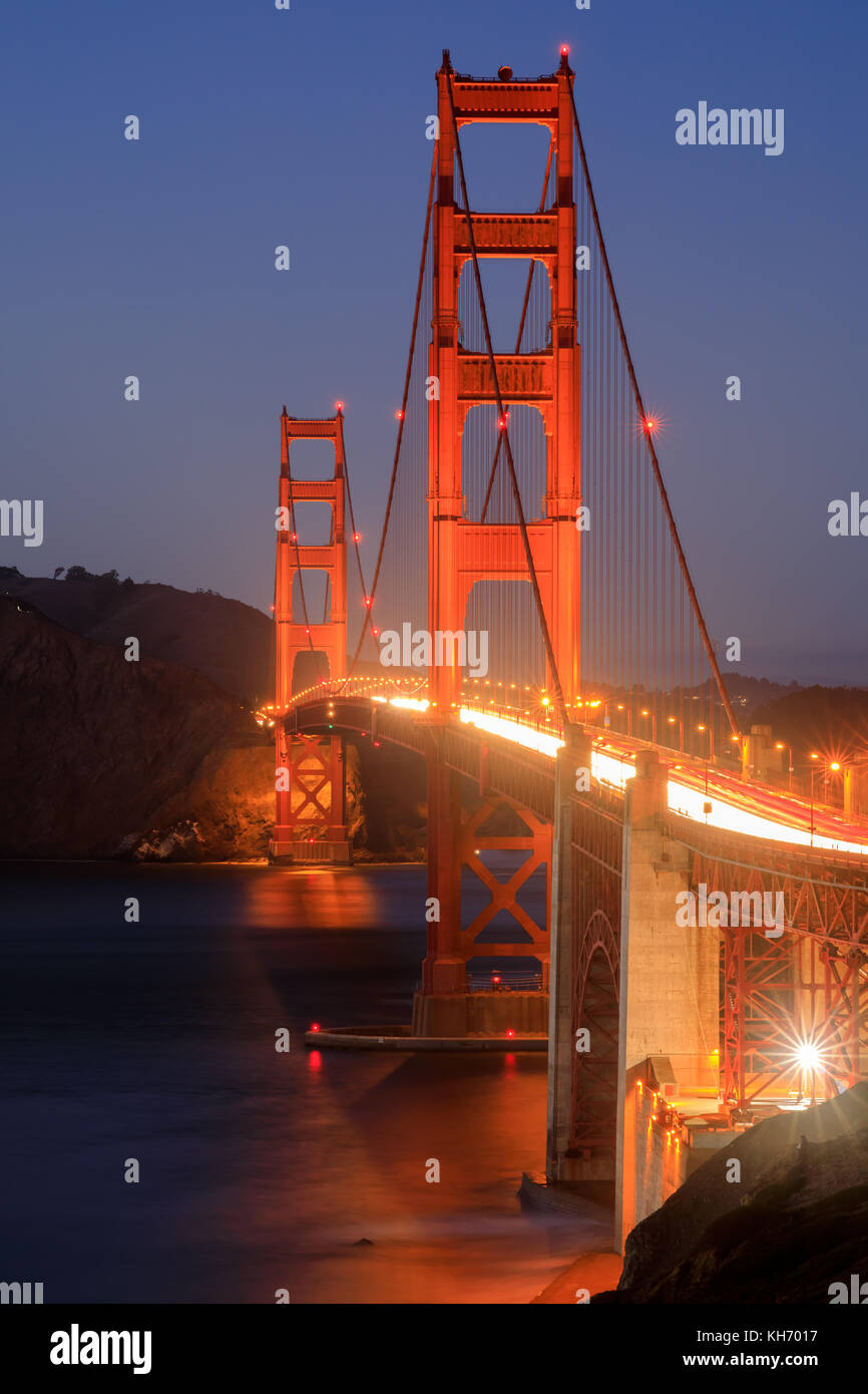 Golden Gate Bridge on a clear evening, as seen from the Presidio. - Stock Image