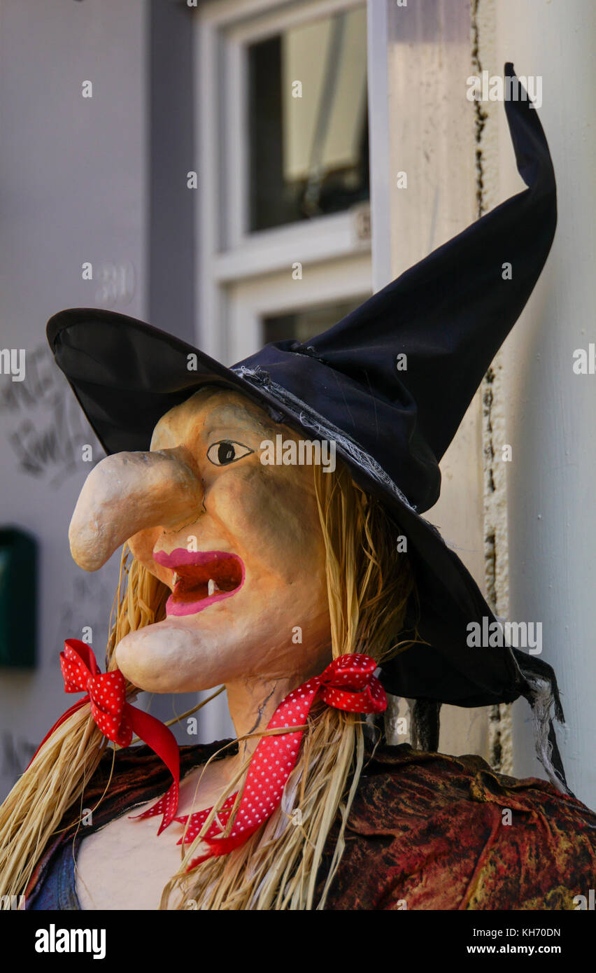 Scarecrow witch with straw hair and a pointy nose - Stock Image