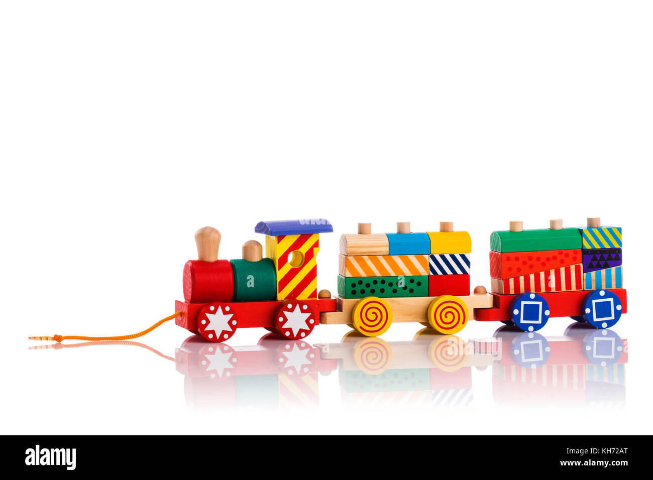 Wooden toy train with colorful blocks isolated over white background. Montessori educational toys. - Stock Image