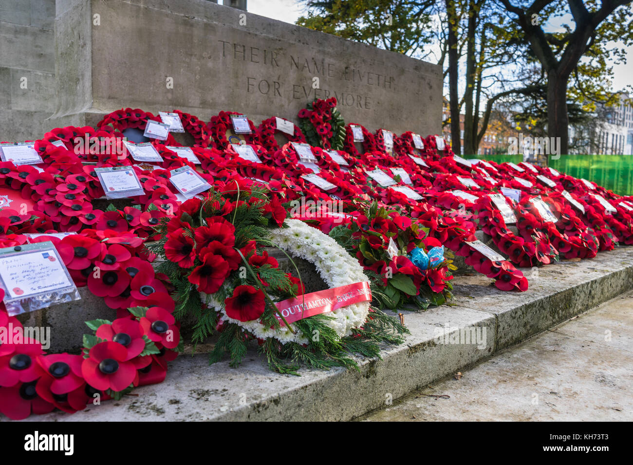 Red poppy wreaths laid during Remembrance Day commemoration at Southampton Cenotaph in November 2017, Hampshire, - Stock Image