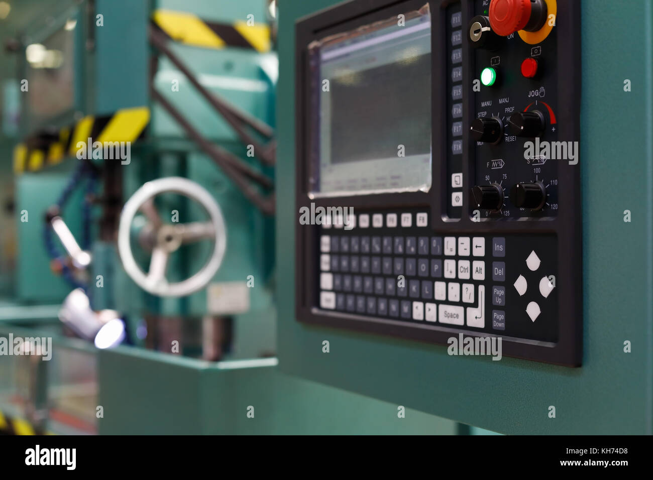 Control panel of the CNC metalworking machine. Selective focus. - Stock Image