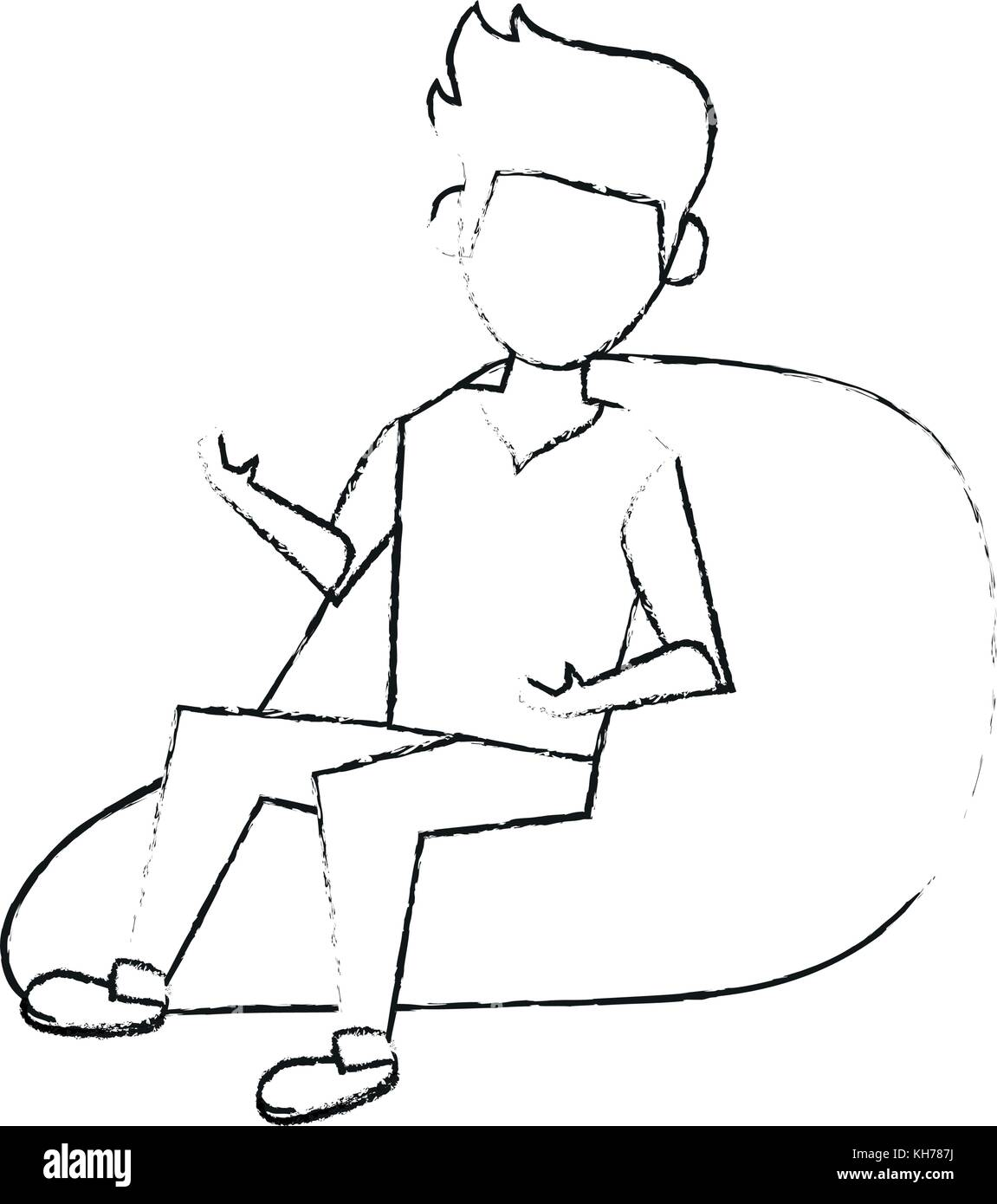 Young man sitting on bean bag - Stock Image