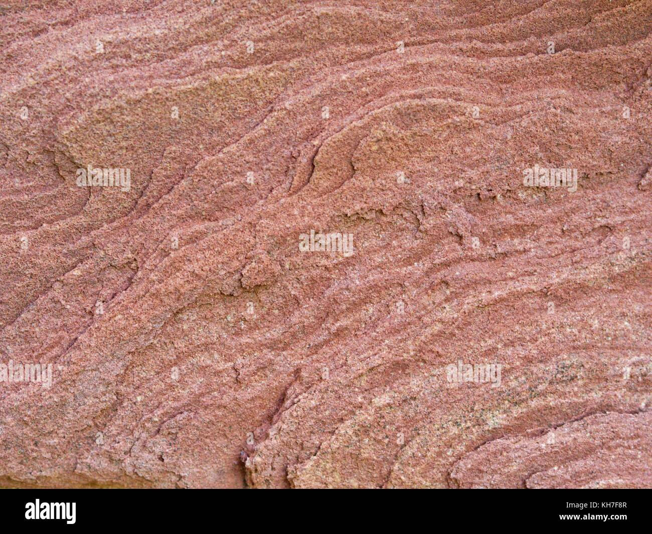 Texture of a reddish rock - Stock Image