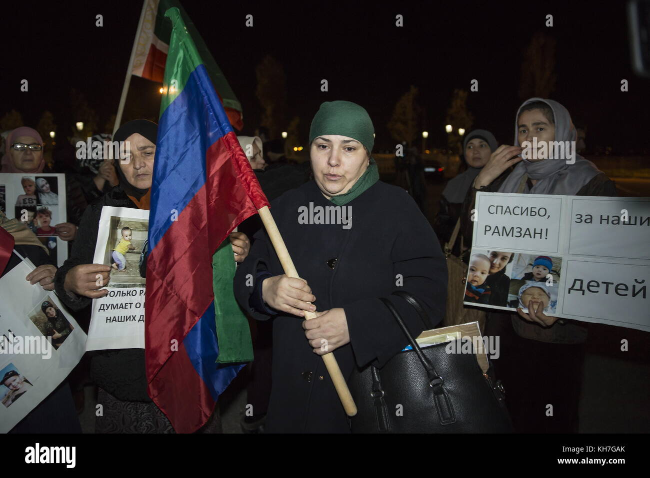 Grozny, Russia. 13th Nov, 2017. People hold photos of their missing relatives and posters thanking Chechnya Head - Stock Image