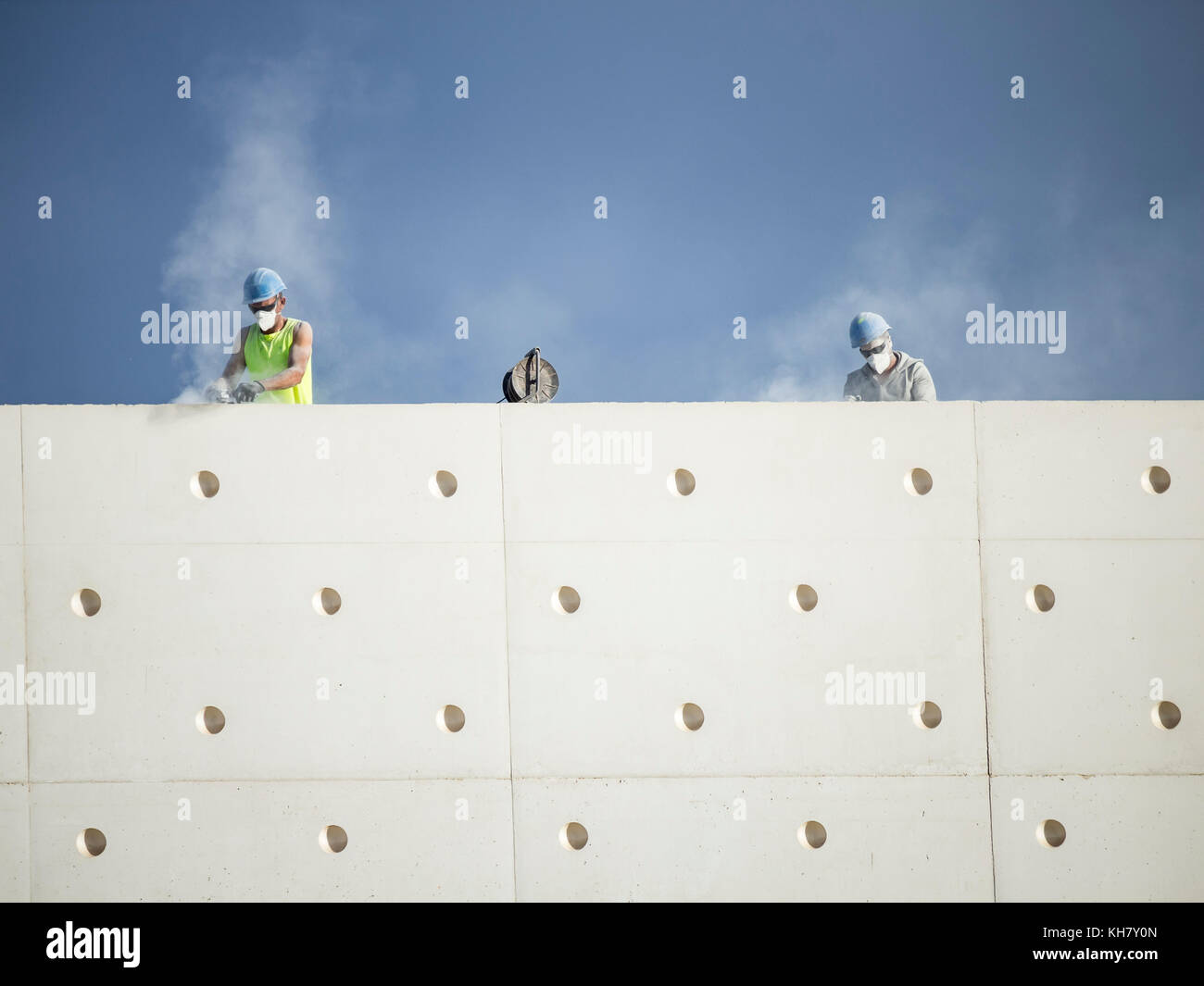 Las Palmas, Gran Canaria, Canary Islands, Spain. 16th Nov, 2017. Hot and dusty work as workmen with grinders clean - Stock Image
