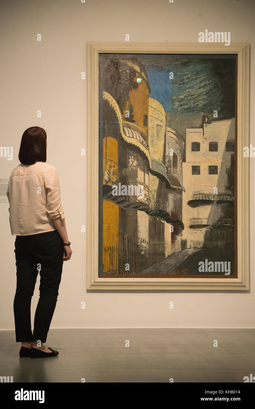 Liverpool, UK. 16th Nov, 2017. Laura Deveney, Tate Liverpool Communications Assistant, views a painting by artist Stock Photo