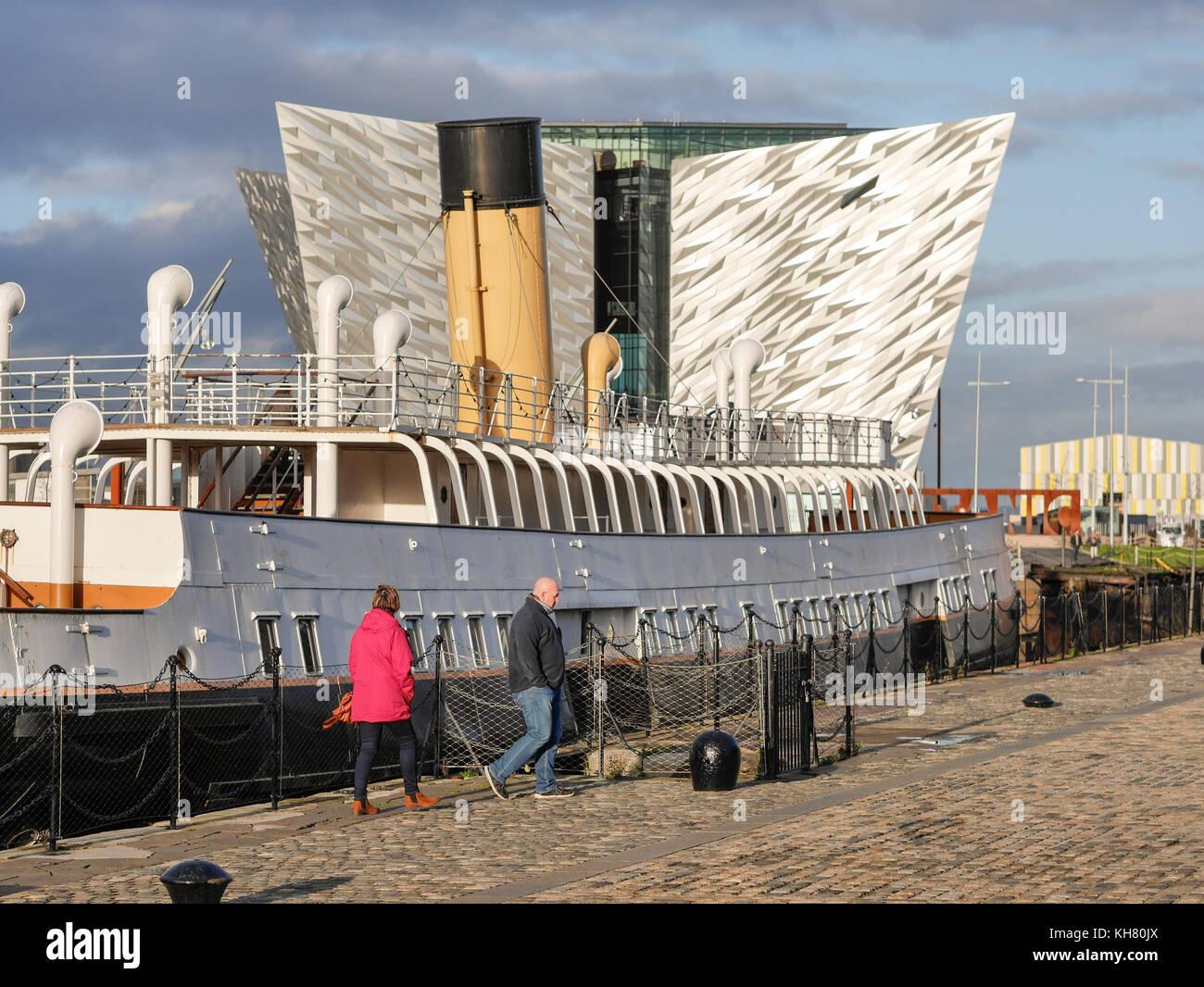 Belfast, Northern Ireland, UK. 16th Nov, 2017. UK weather: SS Nomadic and Titanic Belfast in the sun as Belfast - Stock Image