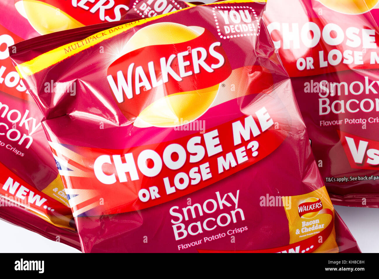 Packets of Walkers smoky bacon flavour crisps with the 'choose me or lose me?' slogan, November 2017, United - Stock Image