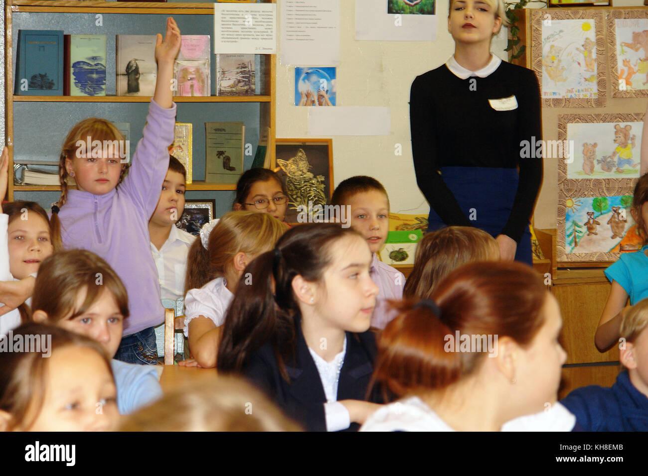 Schoolchildren in classroom at lesson - Stock Image